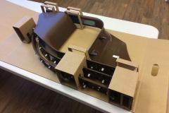 Cardboard box holding custom metal pieces