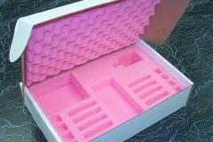 Custom pink foam insert in cardboard box