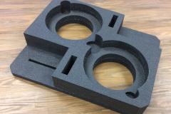 Custom foam insert with circular cutouts